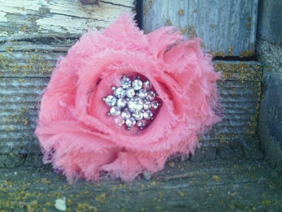 Elegant yet fun flower. Peach rag style flower.  rhinestone center.