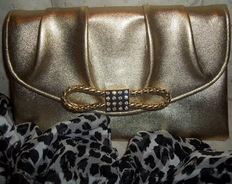Metallic Gold Clutch. 1970s Lame gold handbag. Made by Avon. Leather bow & crystal accent .Repurposed decor.One of a kind