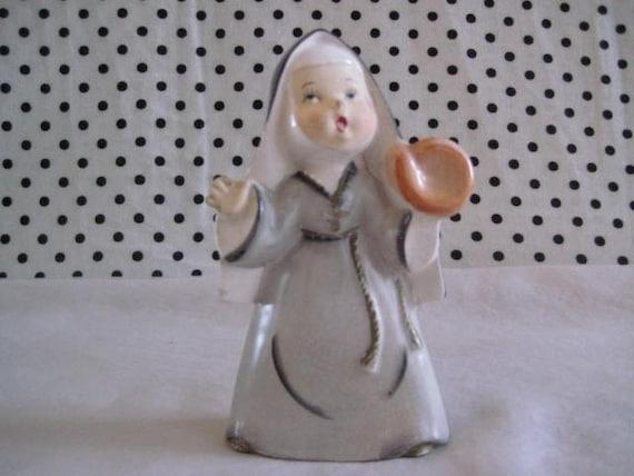 Vintage Ceramic Nun Figurine Playing Baseball at Vintage Heist