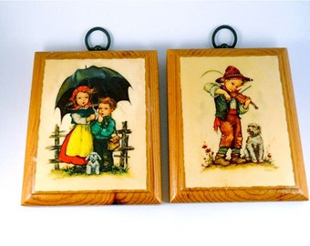 Hilde Prints  Wood Plaques, one a boy with violin, and girl with boy and dog and umbrella