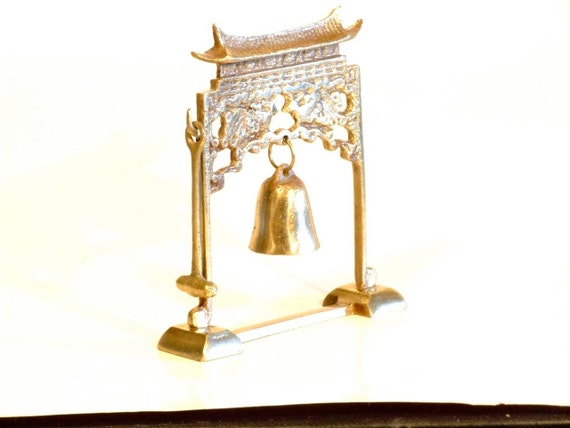 Brass  Meditation Gong Bell with Stricker, has a Pagota and chinese pavilion enbossed in it