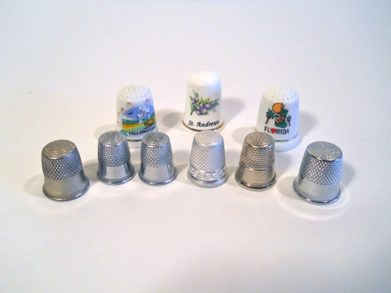 Assortment of nine Thimbles, some German made, and Bone China.