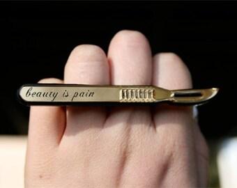 "Custom Salpel Ring ""beauty is pain"""