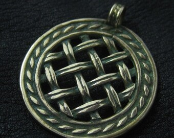 Bronze pendant from medieval Russia