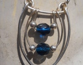 Navy blue faceted glass silver plated swing necklace
