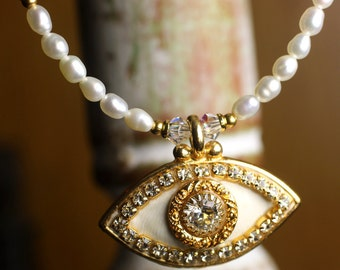 Fresh water pearls and White Gold Evil Eye Necklace from Michal Golan studio