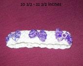 Ivory dog collar with purple rhinestones on bows