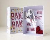 BANG BANG: Cupid shooting down a heart  in a matchbox