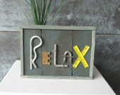 Repurposed metal finds remind you to RELAX