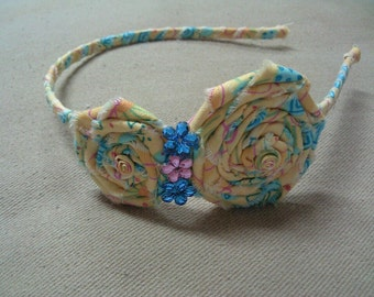 Rolled fabric flower headbands