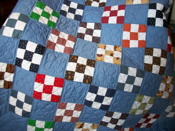Blue quilt with nine-patch design, beautifully hand-quilted.