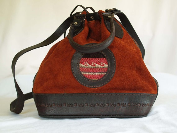 vintage brown leather draw string hand bag.