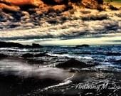 Ocean Sunset Along a Rocky Coast w/ Blue Water