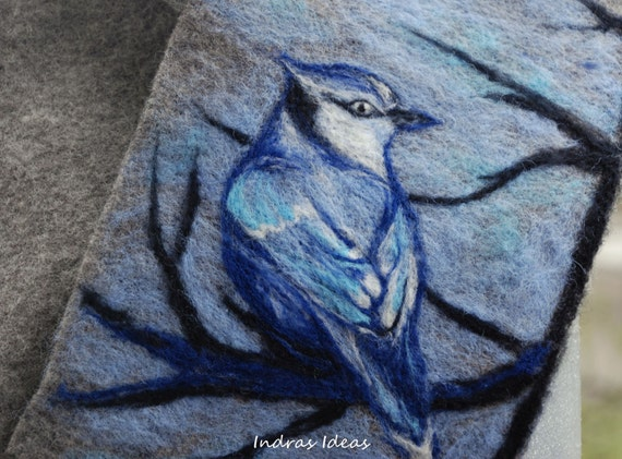 Practical, original and comfortable scarf with blue bird felted on it.