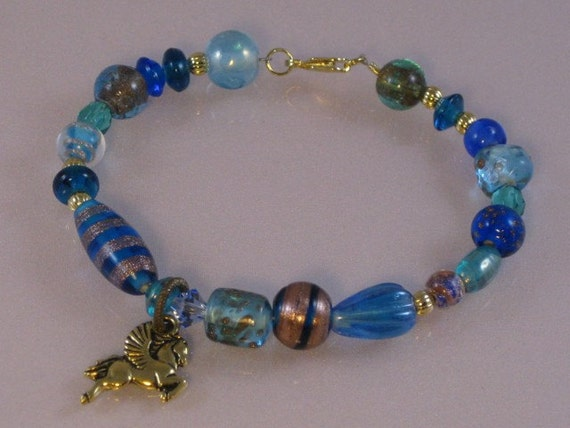 Reserved for Jan-Blue & gold fancy glass bracelet with pagasus charm: charity donation