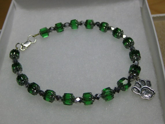 Green glass and silver paw charm bracelet: charity donation
