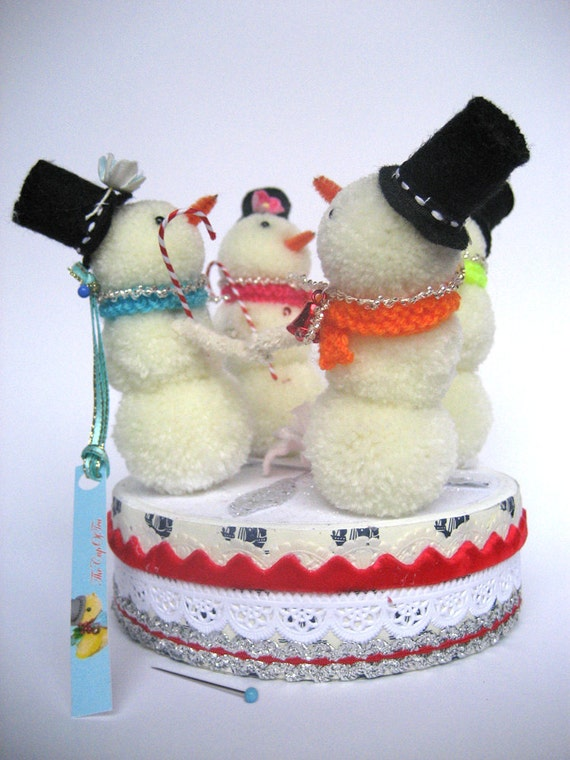 Snowmen playing on the Ice