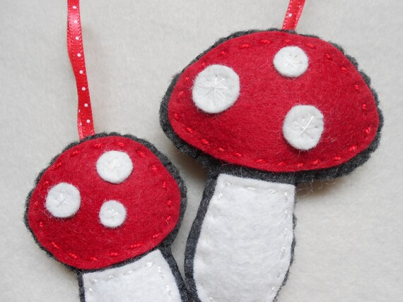 Two felt woodland mushroom ornaments