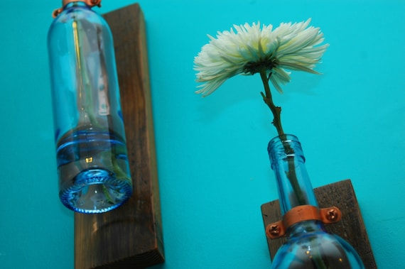hanging wall vases made from recycled materials.