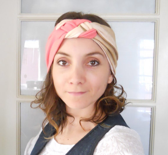Use coupon code SAVE10 to receive 10% off knotted turban Headbands for women made of elastic fabric in marble cream and salmon color