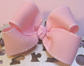 "Boutique style everyday 4"" bow in baby soft pink with white saddle stitching"
