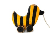 Vintage handmade pull toy. Bumblee bee striped duck wood pull toy on wheels