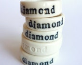 Porcelain ring with imprinted text: diamond. Size 5 3/4