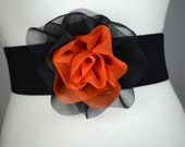 Elastic Belt with Orange and Black Flower .... Only flower for 9.00