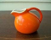 Pumpkin orange ball pitcher.  Miniature USA orange creamer.