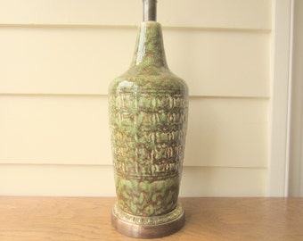 Exceptional character Mid Century green ceramic lamp.