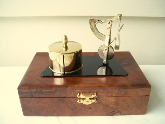 Vintage brass stamp dispenser.  Brass postal scale.