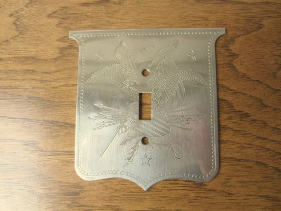 United States Great Seal silver light switch plate.  Federal style silver light switch plate.