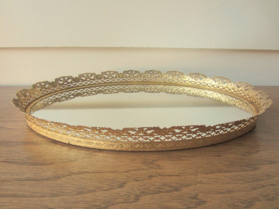 Vintage gold oval mirror dresser caddy.  Gold filigree dresser mirror.
