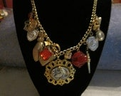 Boho ro mermaid cameo necklace new with old charms red shiny gold one of kind vintage beads rhinestones heats lady hand fleur de lis coin