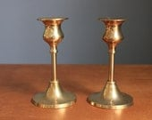 pair of delicate brass candlesticks
