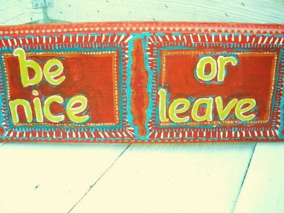 Folk art sign be nice or leave
