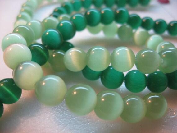 22 pcs of emerald green 22  pastel  green Cat Eye Beads