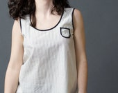 Black and white striped shirt, sleeveless w/breast pocket