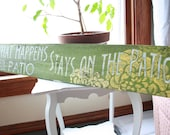 What Happens on the Patio Weathered Sign