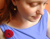 the red dahlia wedding boutonniere