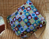 Hand Crocheted Granny Square cushion in calm shades of burgundy, green and mocha