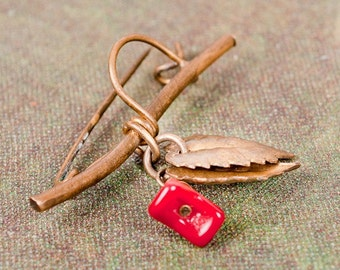 Vintage reconstructed brooch, twig with leaf and red flower