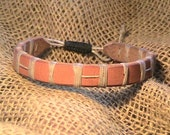 Leather hand stitched bracelet. B60