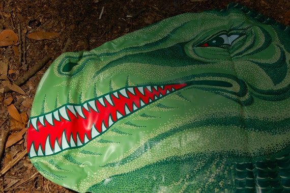 "Vintage inflatable Tyrannosaurus Rex... Unused in box... 55"" TALL"
