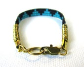 the MOUNTAINS bracelet // Aqua and black with brass rings