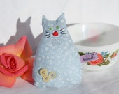 Smelly Cat, Blue with Light Blue flowers. Yellow Buttons