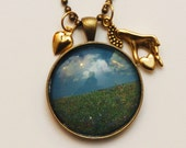 Necklace: Lucky, Surreal Landscape with Blue Skies and Green Grass and Lady Hand Necklace