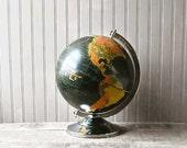 Starlight 12-inch black globe, circa late 1950's