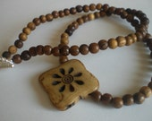 Natural Wood Beaded Necklace with Carved Flower Bone Pendant