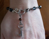 The artist rosary in blue crystals, gunmetal and sterling silver key